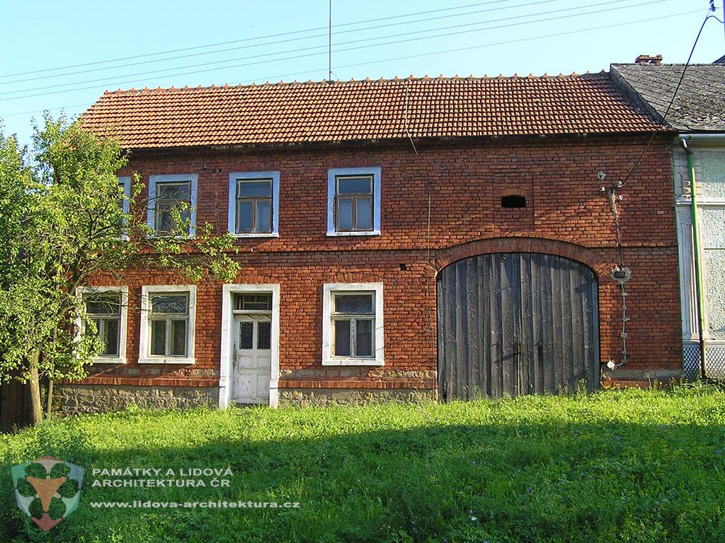 Two-storey brick house on a stone base