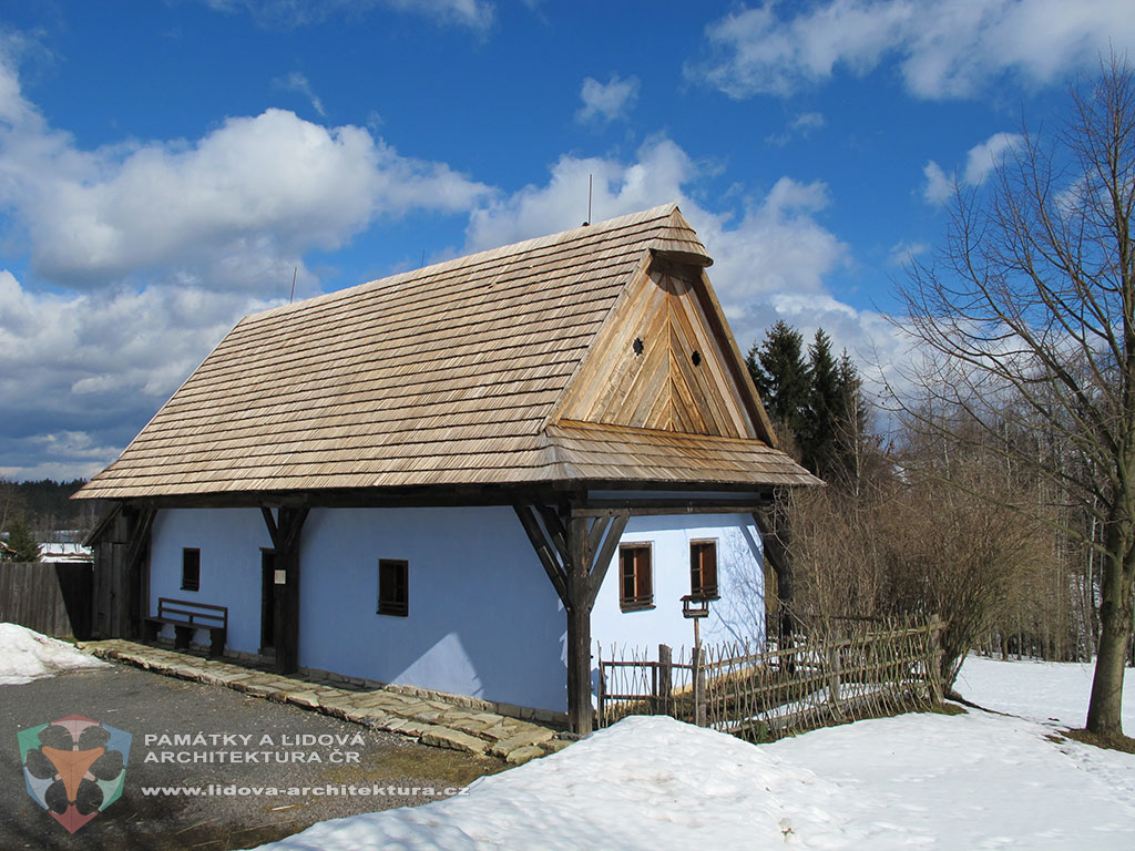 House with gabled roof having small conical roof at the top of the gable