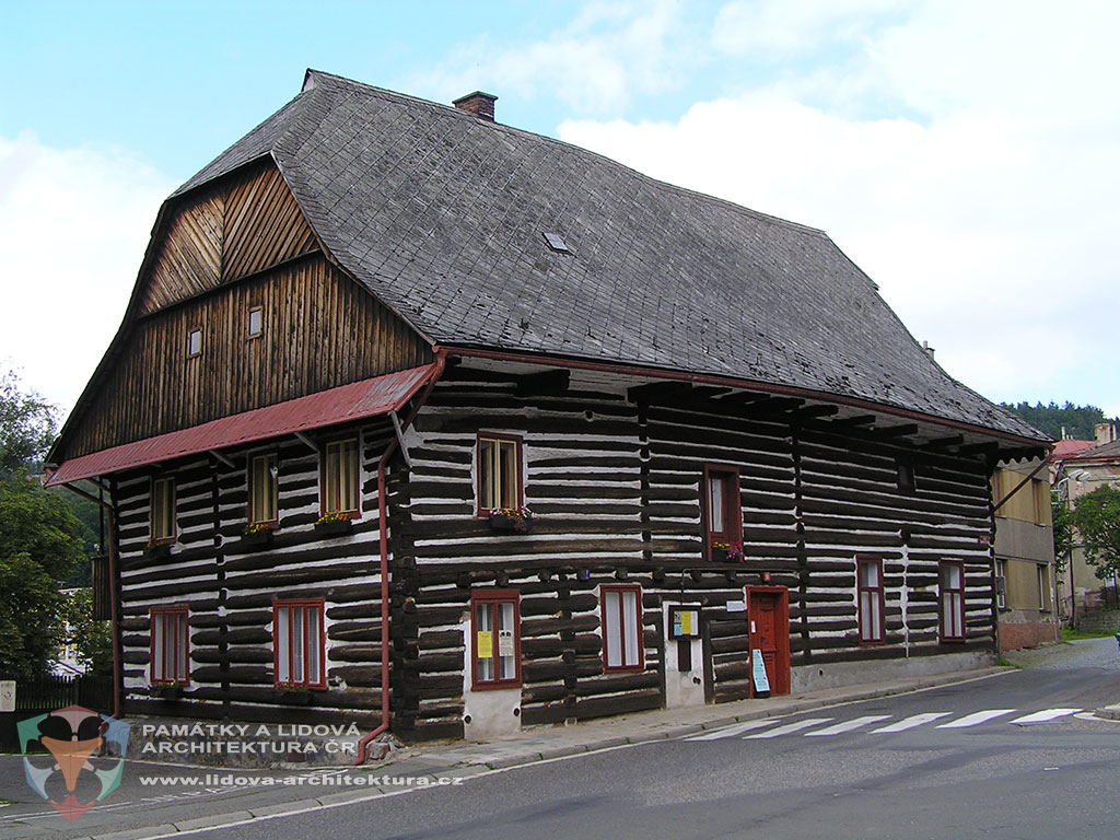 Two-storey house built of logs